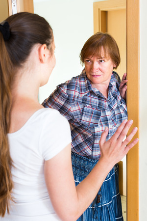 surly: Mature dissatisfied mother greeting her young daughter