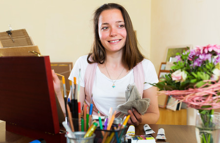 contentedness: Positive adult artist in the process of creating a new picture Stock Photo