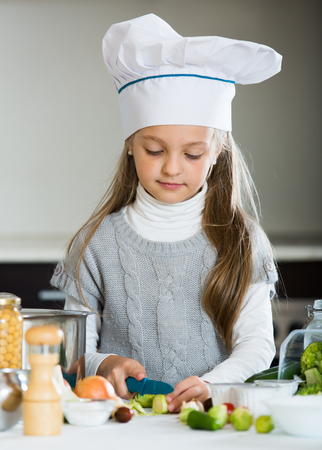 broccoli sprouts: Portrait of sweet little girl with Brussels sprouts and broccoli Stock Photo