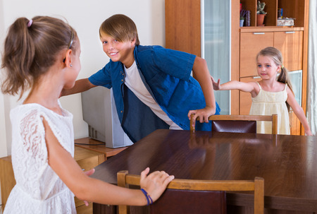 romp: Happy kids playing romp game Touch-last at home