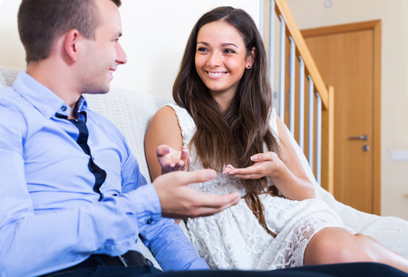 husband: Portrait of happy young couple chatting and laughing in domestic interior Stock Photo