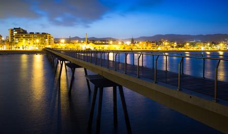fabrica: Pier at beach of Badalona  in evening. Catalonia