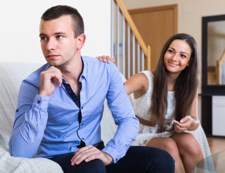 failing: american  adult failing to settle an domestic argument indoors Stock Photo