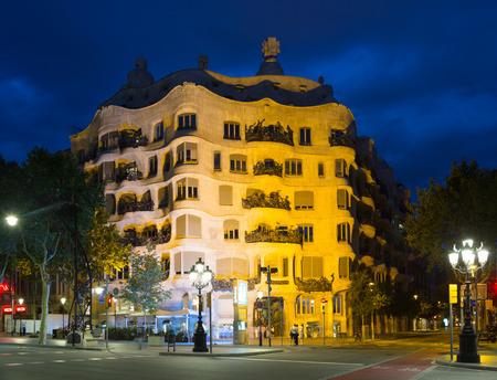 BARCELONA, SPAIN - JUNE 23, 2015: Night view of Casa Mila (La Pedrera)   in Barcelona, Catalonia Editorial