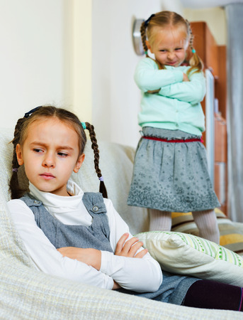 4s: Portrait of two miserable girls having conflict at home
