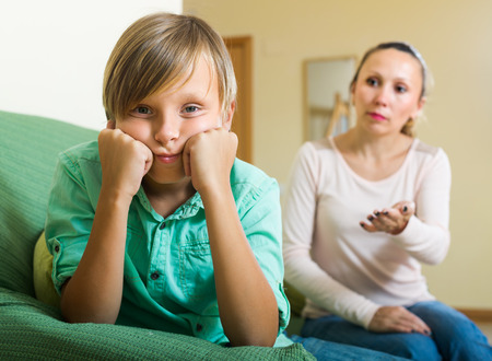 10 12: Mature mother and sad teenager son after  conflict at home
