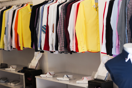 shirts on hangers: apparel store with men shirts on hangers