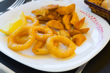 calamares: Calamares a La Romana Fried Squid   on  plate at  table Stock Photo