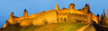 antiquary: Panorama of Medieval Castle at Carcassonne in twilight time.  France Stock Photo