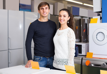 hobs: Young man and woman at household appliances section of supermarket