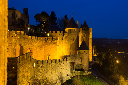 antiquary: Walls and medieval  fortified city in evening time.  Carcassonne, France