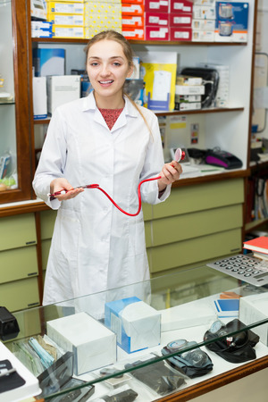 orthopaedic: Female doctor posing near display with the orthopaedic products and treatment