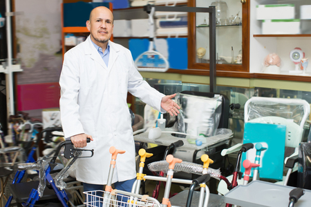 orthopaedic: Therapeutist posing near display with orthopaedic equipment and machines Stock Photo
