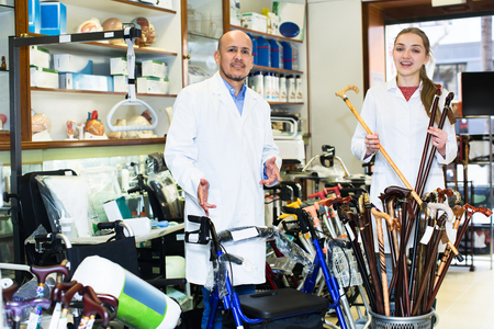 orthopaedic: Two consultants working in the special store with a orthopaedic goods. Focus on man Stock Photo