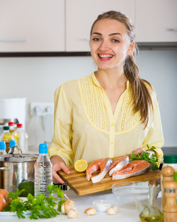 corcovado: Female with long hair preparing trout dish at home