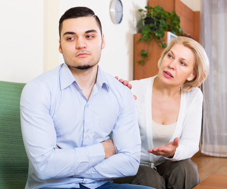mismatch: Mature blonde female explaining something to offended young man