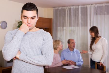 misunderstanding: Man faced with misunderstanding family