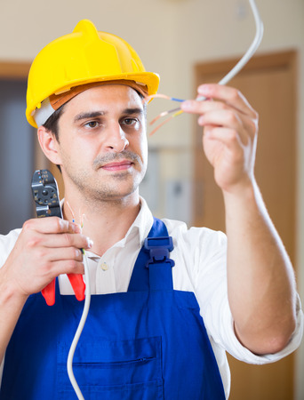 concealed: Professional electrician working with wires at client home Stock Photo