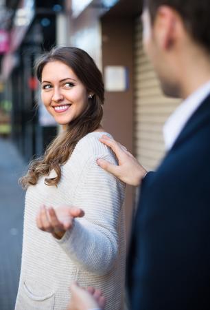 molestation: Happy female smiling back at nice-looking male stranger