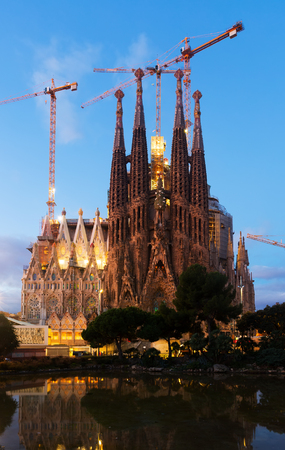 planned: BARCELONA, SPAIN - NOVEMBER 23, 2015: Sagrada Familia in twilight. Barcelona. Basilica and Expiatory Church of Holy Family by Gaudi, building is begun in 1882 and completion is planned in 2030
