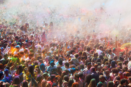 trituration: BARCELONA, SPAIN - APRIL 12, 2015: Many dirty people during   Festival de los colores Holi at Barcelona. Holi is traditional holiday  of India