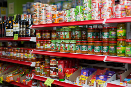 canned goods: BARCELONA, SPAIN - MARCH 22, 2015: Canned goods at groceries section of average Polish supermarket in Barcelona.