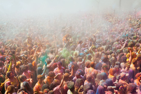 trituration: BARCELONA, SPAIN - APRIL 12, 2015: Many happy dirty people at Festival de los colores Holy