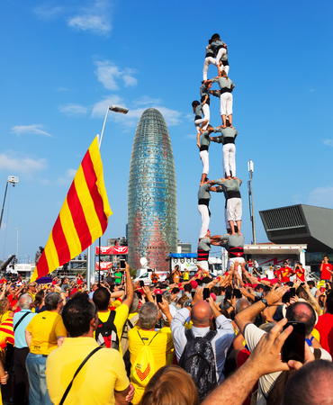 demanding: BARCELONA, SPAIN - SEPTEMBER 11, 2014: Castellers in Barcelona. Rally demanding independence for Catalonia in 300th anniversary of loss of independence