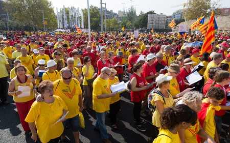 independency: BARCELONA, SPAIN - SEPTEMBER 11, 2014: People are singing at rally demanding independence for Catalonia in Barcelona