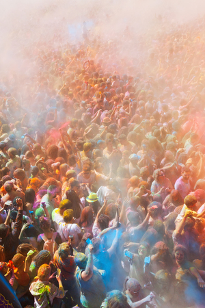 holi: BARCELONA, SPAIN - APRIL 12, 2015: Many happy people during   Festival of colours Holi at Barcelona. Holi is traditional holiday of India