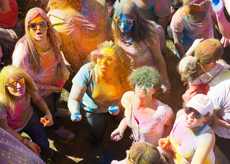 colores: BARCELONA, SPAIN - APRIL 12, 2015: Happy women at  Festival de los colores Holi in Barcelona. Holi is traditional holiday of India