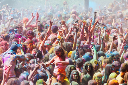 trituration: BARCELONA, SPAIN - APRIL 12, 2015: People at  Festival de los colores Holi in Barcelona. Holi is traditional holiday of India