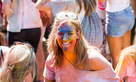 trituration: BARCELONA, SPAIN - APRIL 12, 2015: Happy woman at  Festival de los colores Holi in Barcelona. Holi is  holiday of India