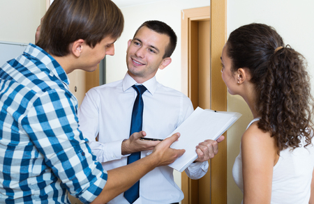 forcing: Positive salesman  forcing family couple to buy subscriptions