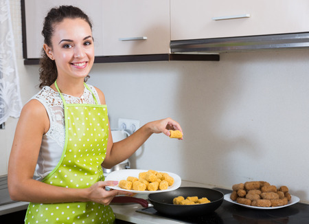 crocchette: woman frying filled croquettes