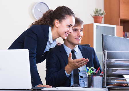 Secret office romance between colleagues: touching by stealth Stock Photo