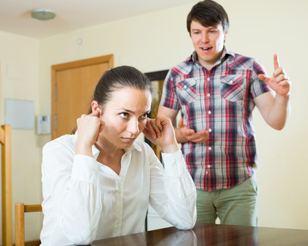 squabble: russian woman having problems with her husband at home