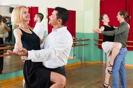 tango: Three young couples having tango class at dance studio. Selective focus Stock Photo