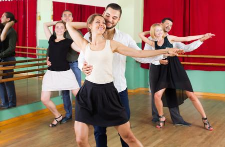 tango: Three positive couples having tango class at dance studio. Selective focus Stock Photo