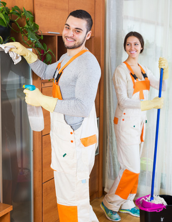 houseman: Positive professional cleaners with equipment clean furniture of client house