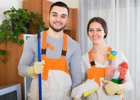 cleaning team: Portrait of cleaning premises team with equipment at client house Stock Photo