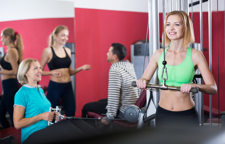 anaerobic: People of different age training in gym Stock Photo