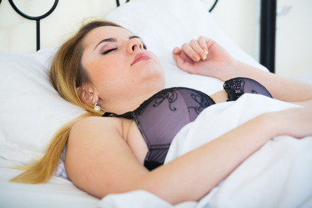 drowse: Beautiful young blondie sleeping in bed at home Stock Photo