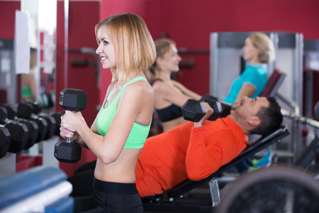anaerobic: Adults people of different age having strength training in gym
