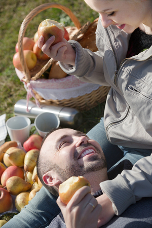 sandwitch: Portrait of young positive adults with apples and sandwitches in nature