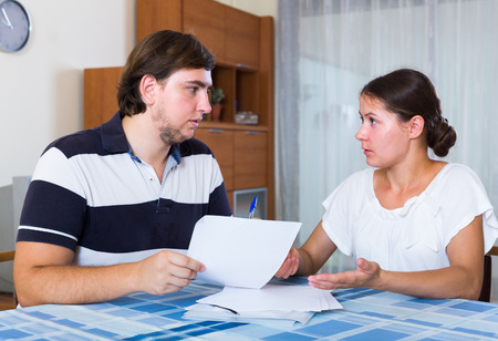 thoroughly: Serious spouses discussing banking statement at home Stock Photo