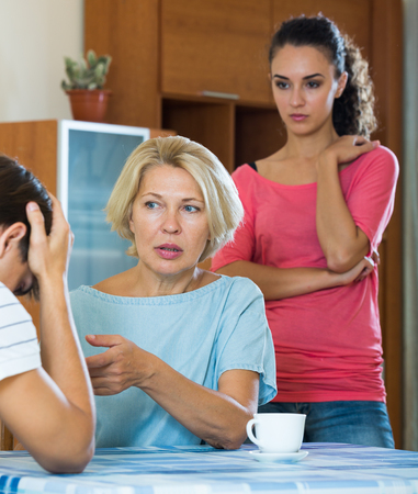 son in law: Young spouses and mother-in-low arguing indoors