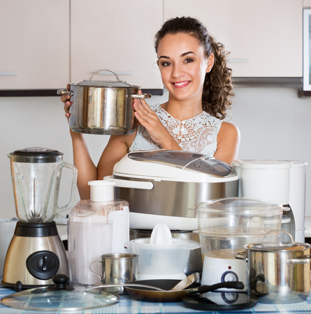 casalinga: Happy housewife with a kitchen appliances at a home Archivio Fotografico