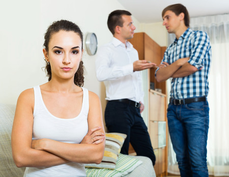 keeping room: Sad young russian girl having argue with her friends at home. focus on girl Stock Photo