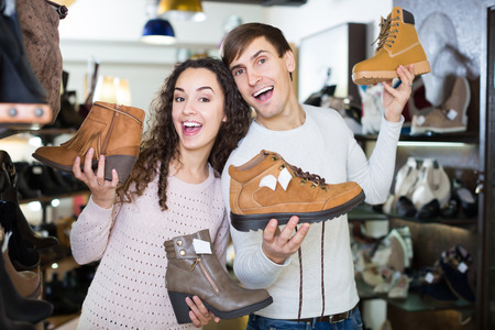 footgear: Smiling couple shopping at fashion shoe store Stock Photo